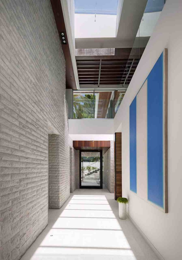 massive-ultramodern-hillside-los-angeles-jet-set-estate-7-entry-hall-rear.jpg