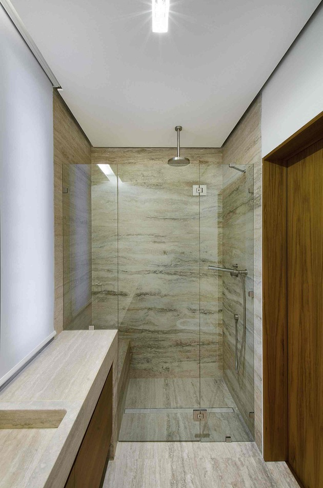 minimal-italian-home-blends-unique-stone-wood-finishes-22-shower.jpg