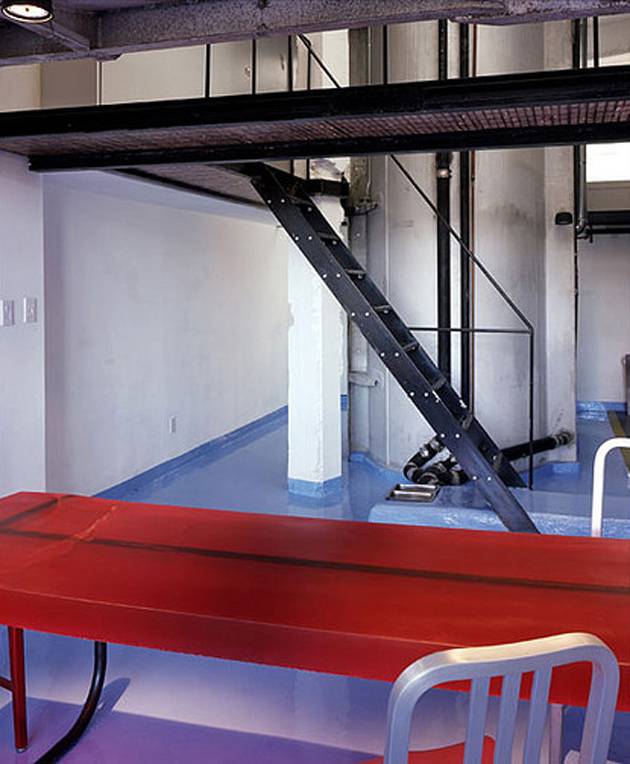 modern-loft-of-transformed-tankers-and-fire-escape-stairs-4.jpg