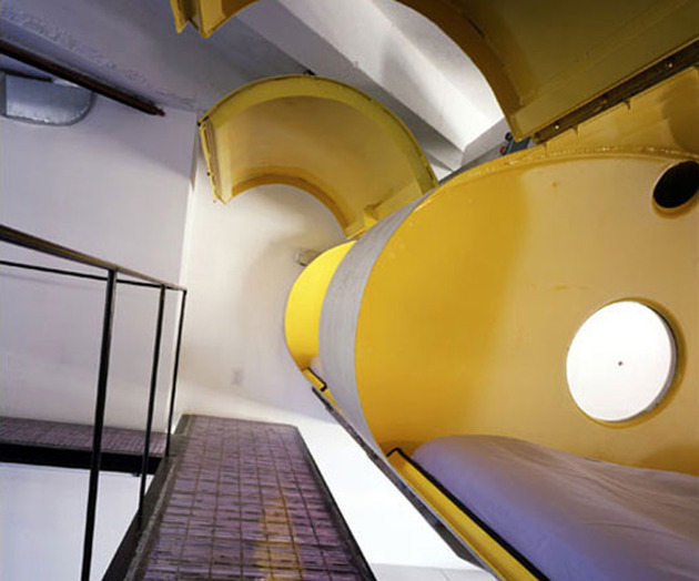 modern-loft-of-transformed-tankers-and-fire-escape-stairs-6.jpg