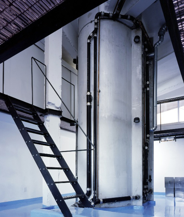 modern-loft-of-transformed-tankers-and-fire-escape-stairs-7.jpg