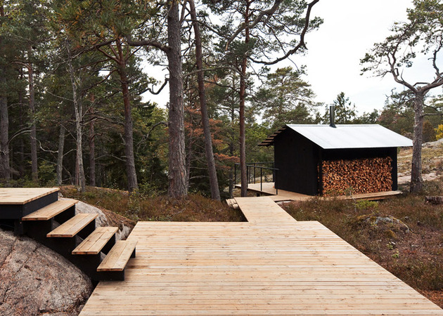 single storey summer house overlooks forested gorge sweden 2 wood shed thumb 630x450 19336 Single Story Summer House Overlooks Forested Gorge in Sweden