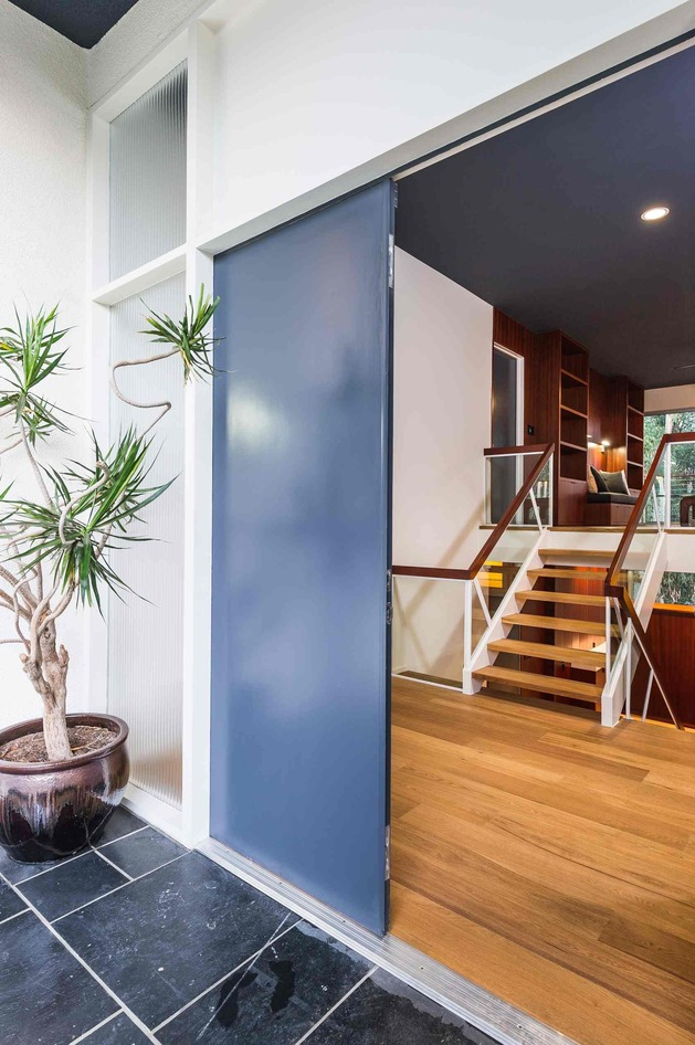 skillful-renovation-iconic-mid-century-los-angeles-residence-12-front-door-open.jpg