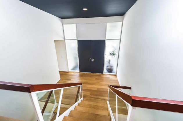 skillful-renovation-iconic-mid-century-los-angeles-residence-13-front-door-stairs.jpg