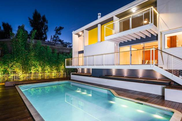 skillful-renovation-iconic-mid-century-los-angeles-residence-5-opposite-pool-angle.jpg