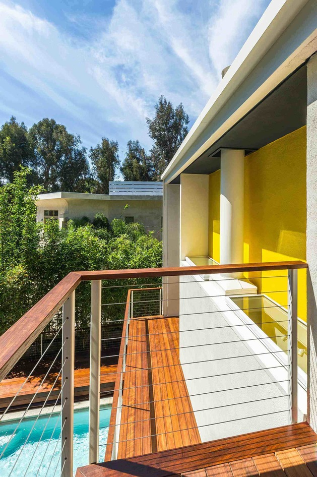 skillful-renovation-iconic-mid-century-los-angeles-residence-6-balcony-yellow.jpg