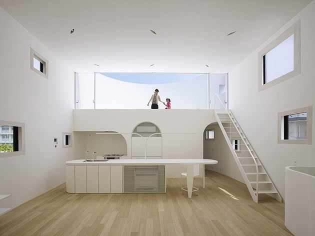spacious-oval-plan-hiroshima-home-uses-light-creatively-10-living-room-straight.jpg