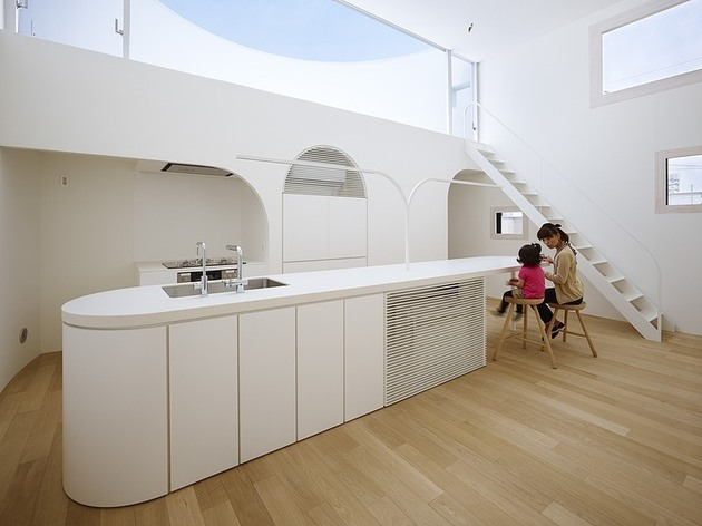 spacious-oval-plan-hiroshima-home-uses-light-creatively-11-kitchen-area.jpg