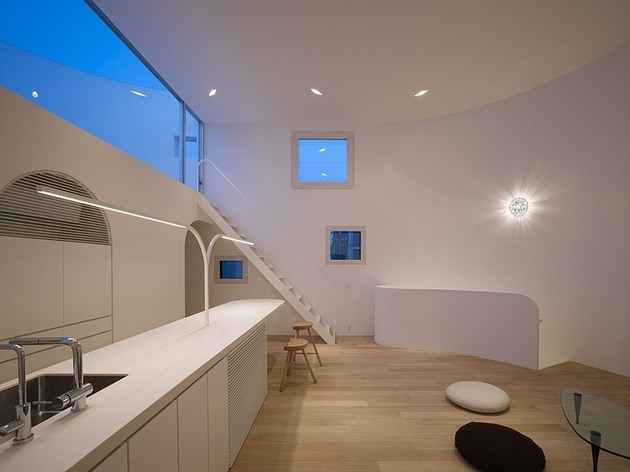 spacious-oval-plan-hiroshima-home-uses-light-creatively-14-living-room-sideways-night.jpg