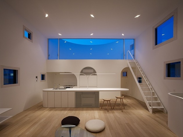 spacious-oval-plan-hiroshima-home-uses-light-creatively-15-living-room-straight-night.jpg