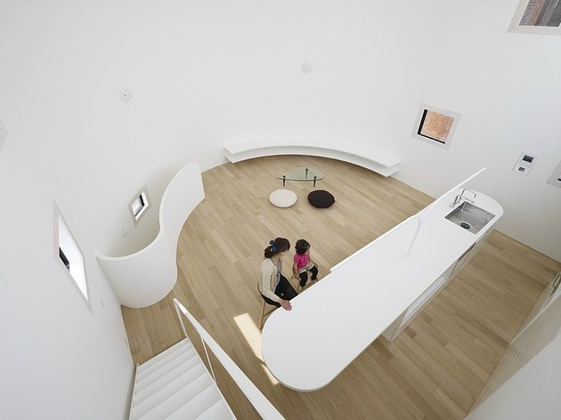 spacious-oval-plan-hiroshima-home-uses-light-creatively-9-living-room-above.jpg