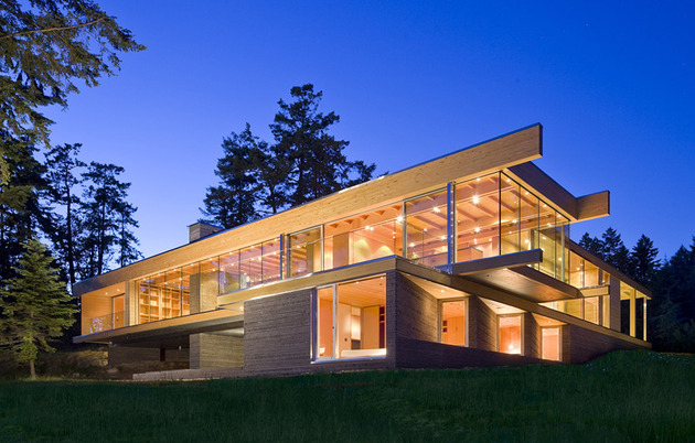 sprawling multifaceted canadian home features glass all sides 1 front angle thumb 630x402 21942 Sprawling Multifaceted Canadian Home Features Glass On All Sides