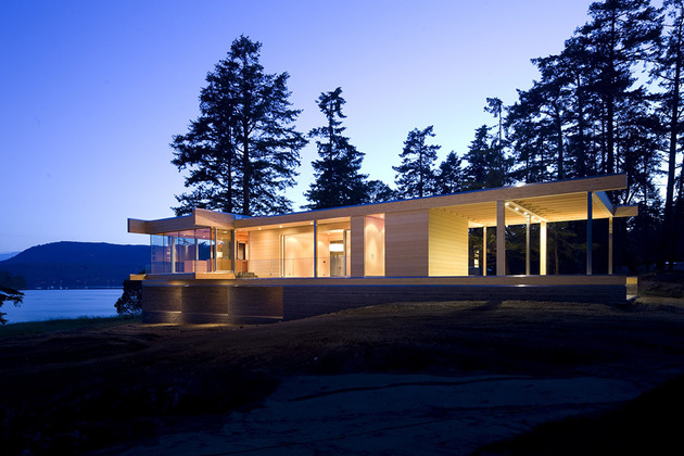 sprawling-multifaceted-canadian-home-features-glass-all-sides-3-long-side-angle.jpg