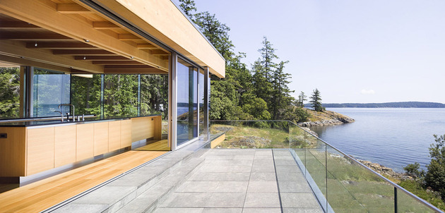 sprawling-multifaceted-canadian-home-features-glass-all-sides-7-stone-patio.jpg