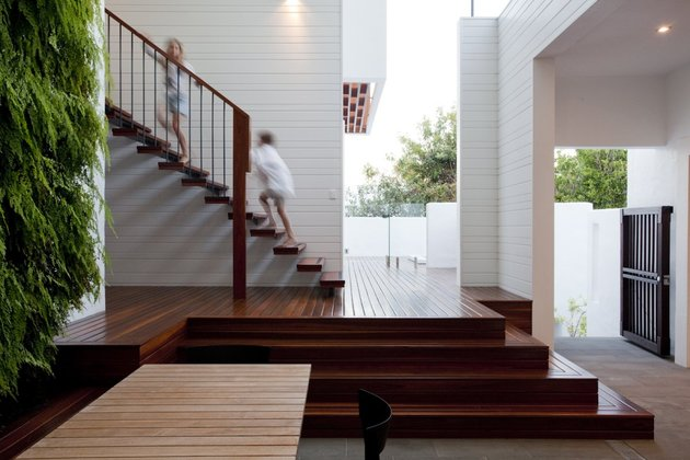 stunningly-reinvented-australian-home-features-towering-indoor-outdoor-courtyard-7-stairs-side.jpg