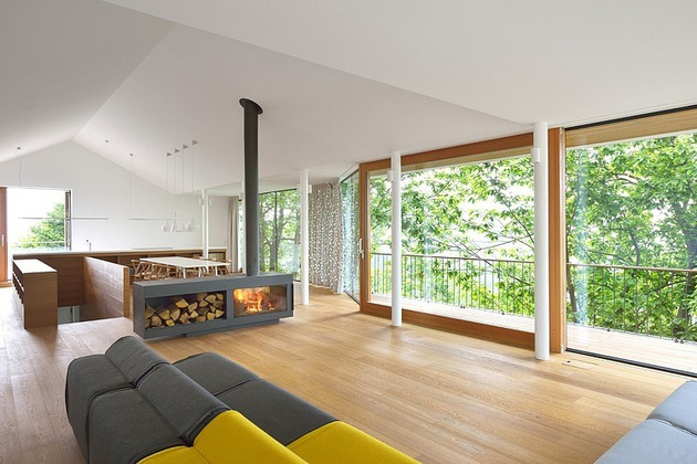 timber-slope-house-lined-with-glass-walls-and-terraces-4.jpg