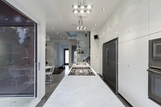 torontos-totem-house-built-around-vertical-art-gallery-5.jpg
