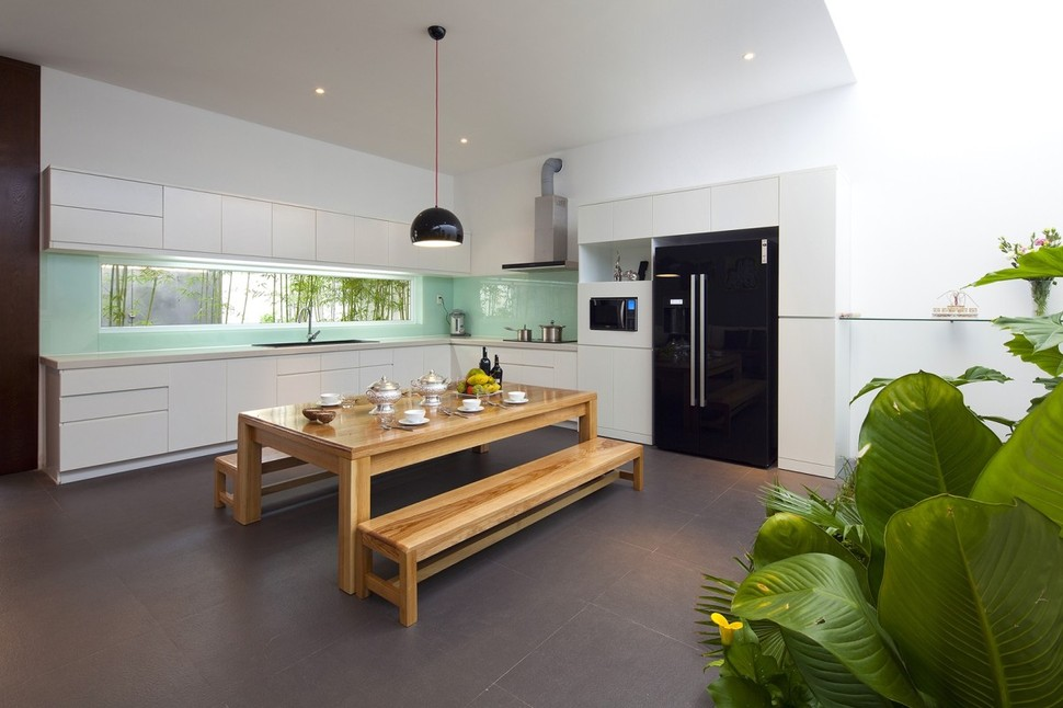 Urban Vietnamese House Garden Kitchen Dining And Living Space