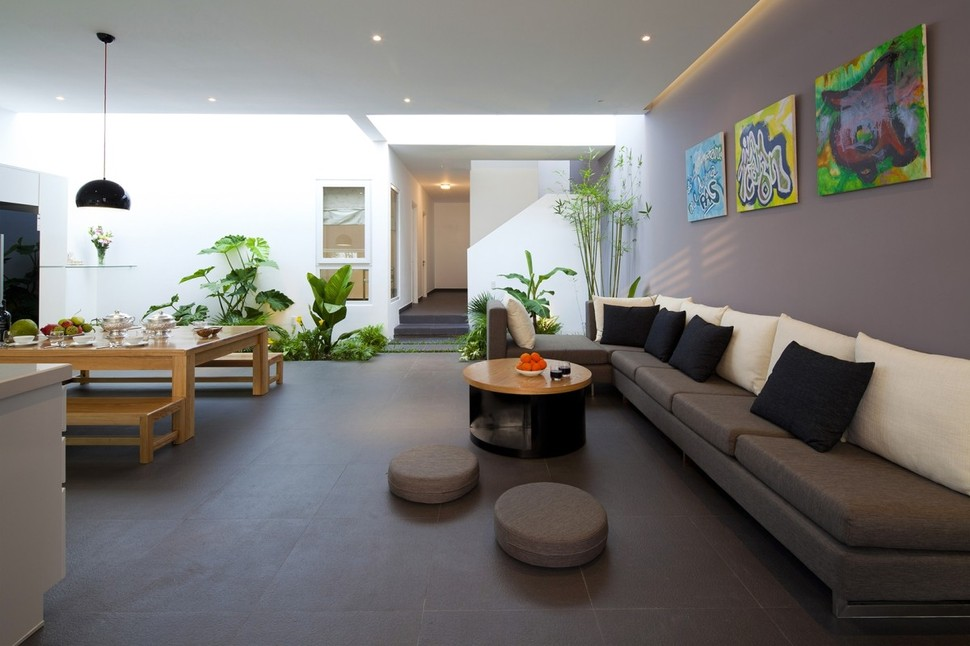 View In Gallery Urban Vietnamese House Combined Space Indoor Garden 5 The Homes Kitchen And Living Room