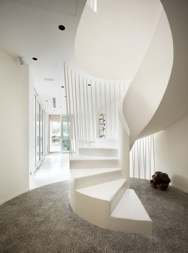 white shades define luxurious multistory milan apartment 1 staircase below rock thumb 630x848 18146 White Shades Define Luxurious Multistory Milan Apartment