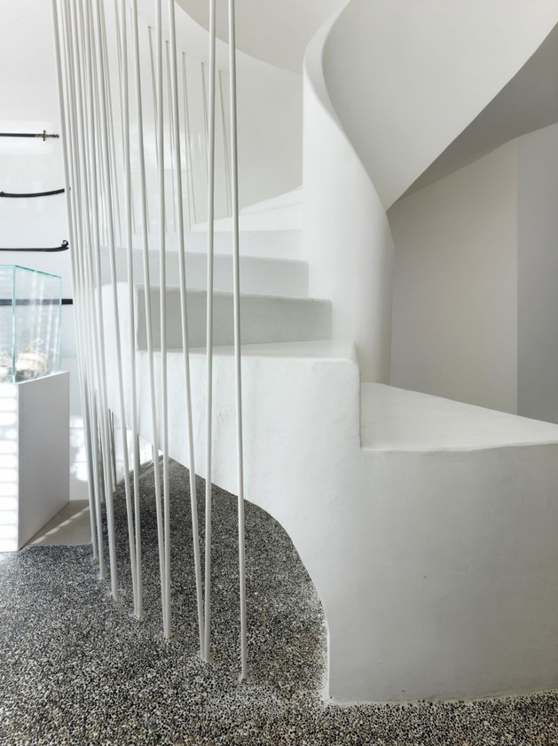 white-shades-define-luxurious-multistory-milan-apartment-5-stairs-bottom-close.jpg