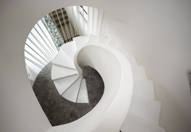 white-shades-define-luxurious-multistory-milan-apartment-7-stairs-down.jpg