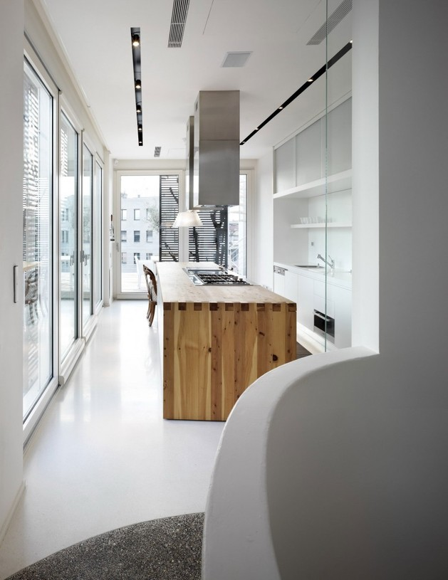 white-shades-define-luxurious-multistory-milan-apartment-8-kitchen-far.jpg