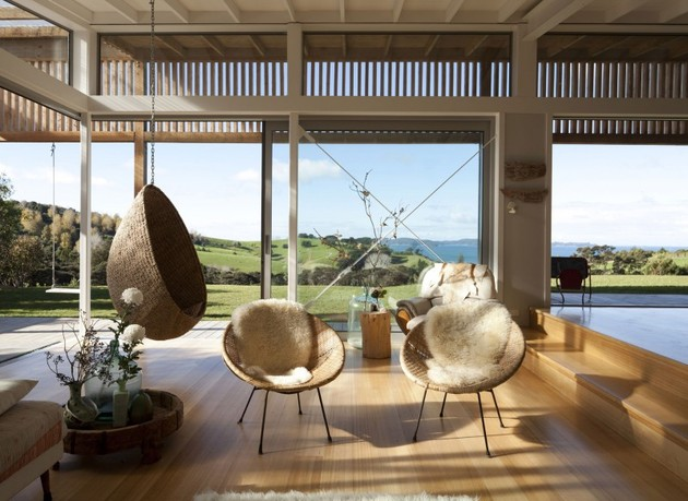 wood-slat-home-with-utterly-open-living-spaces-11-hanging-seat-living-room.jpg