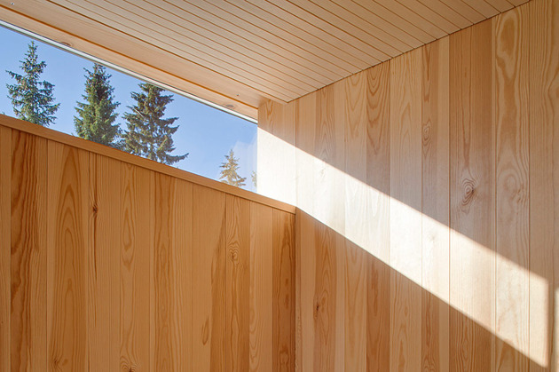 4-season-timber-cottage-built-by-single-carpenter-15-light-angle.jpg