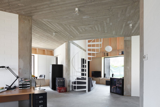 belgium-angle-house-with-concrete-wood-and-brick-interiors-3.jpg