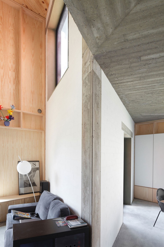 belgium-angle-house-with-concrete-wood-and-brick-interiors-4.jpg