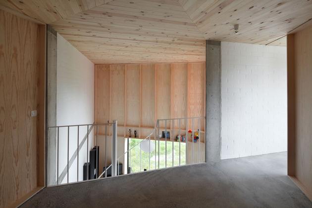 belgium-angle-house-with-concrete-wood-and-brick-interiors-9.jpg