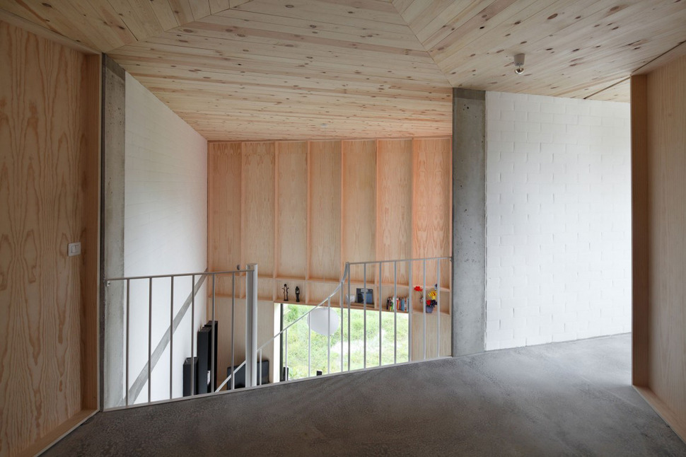 Belgium angle house with concrete wood and brick interiors for Brick and wood home designs