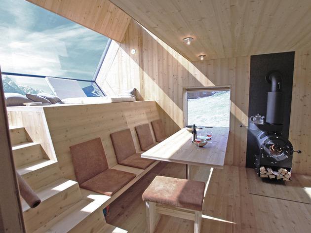 compact-irregularly-shaped-austrian-mountain-house-on-stilts-10-table-windows.jpeg