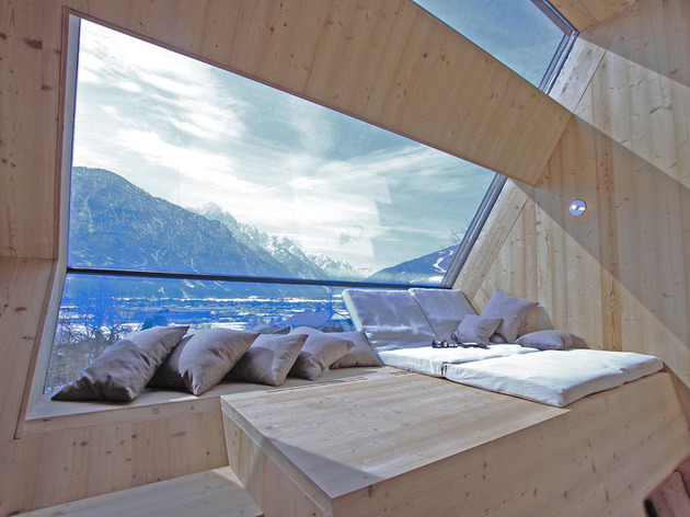 compact-irregularly-shaped-austrian-mountain-house-on-stilts-11-main-window.jpeg