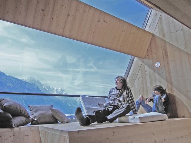 compact-irregularly-shaped-austrian-mountain-house-on-stilts-12-window-people.jpeg