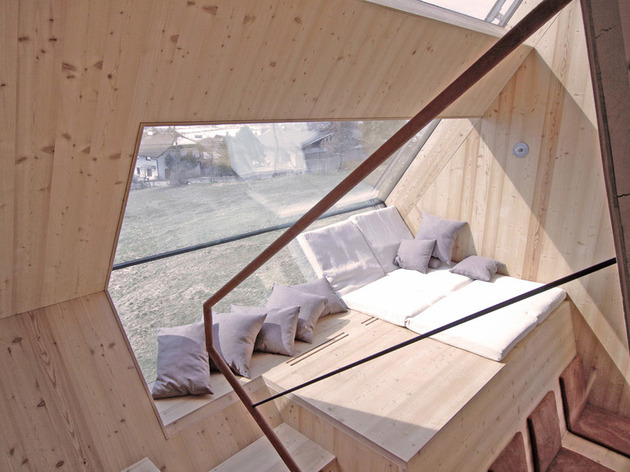 compact-irregularly-shaped-austrian-mountain-house-on-stilts-13-window-from-above.jpeg