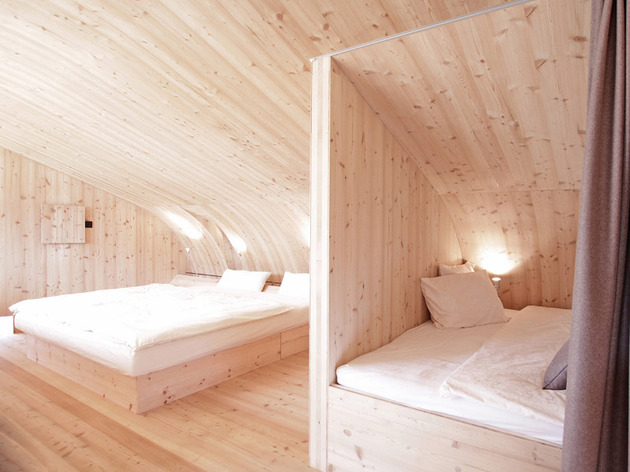 compact-irregularly-shaped-austrian-mountain-house-on-stilts-16-beds-angle.jpeg