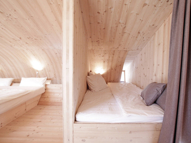 compact-irregularly-shaped-austrian-mountain-house-on-stilts-17-small-bed.jpeg