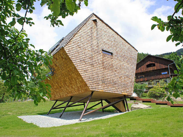 compact irregularly shaped austrian mountain house on stilts 2 side few windows thumb 630x472 23241 Compact Austrian Mountain House On Stilts