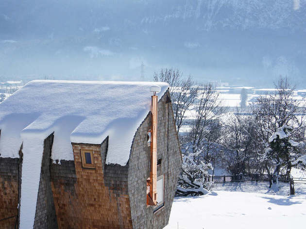 compact-irregularly-shaped-austrian-mountain-house-on-stilts-6-above-winter.jpg