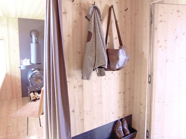compact-irregularly-shaped-austrian-mountain-house-on-stilts-7-coat-rack.jpeg