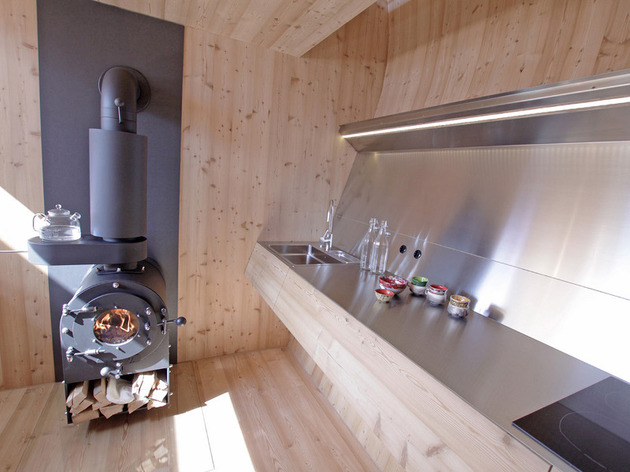 compact-irregularly-shaped-austrian-mountain-house-on-stilts-8-kitchen.jpeg