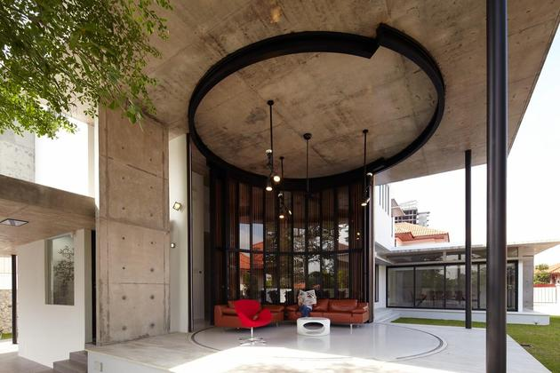 curved-stacking-glass-doors-surround-drum-shaped-room-voila-house-10-living.jpg