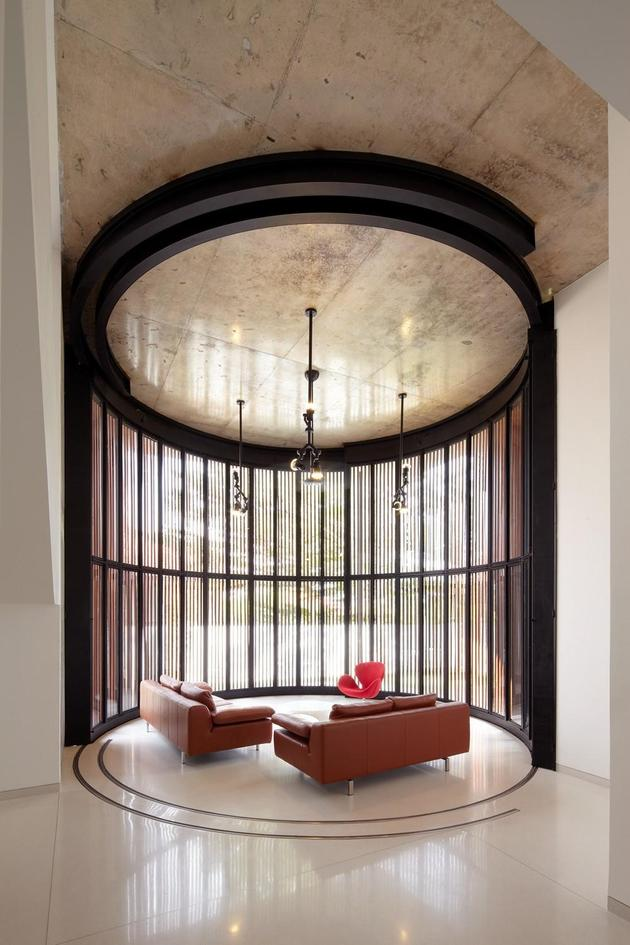 curved-stacking-glass-doors-surround-drum-shaped-room-voila-house-23-drum-closed.jpg