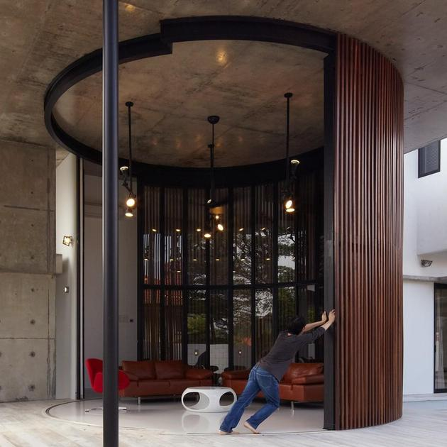 curved-stacking-glass-doors-surround-drum-shaped-room-voila-house-7-drum-opening.jpg