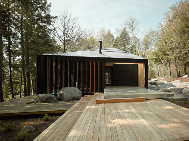 elegant complexity defines color contrasted ontario weekend home 1 side entry thumb 630x472 24116 Trapezoid Shaped Cottage with Plywood Interiors