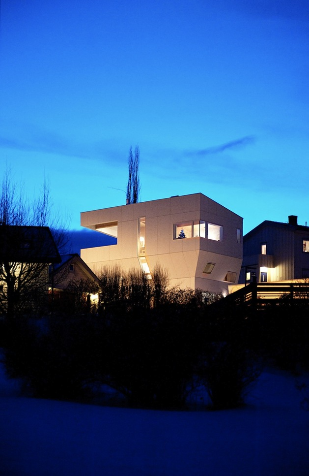 geometric-norwegian-house-with-creative-interior-fixtures-9-back-angle-night.jpg