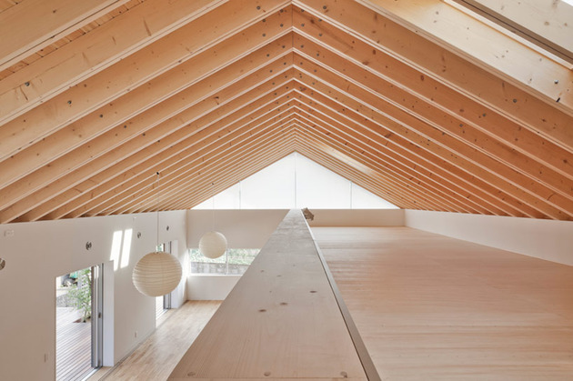 house-with-exposed-timber-rafters-bookshelf-columns-8-railing.jpg