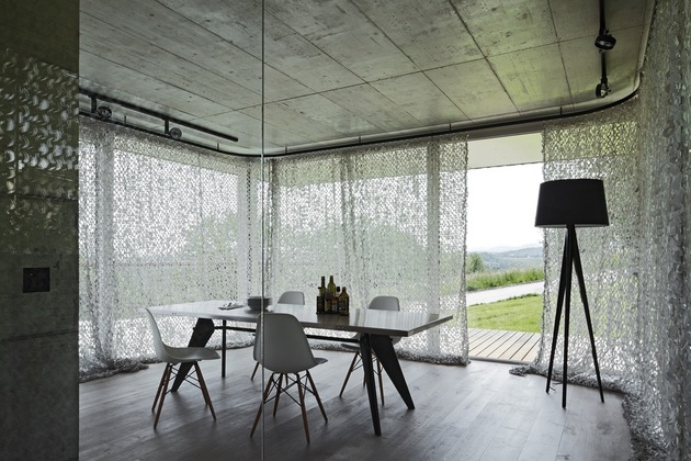 isolated-swiss-countryside-home-glass-encased-lower-floor-6-table.jpg